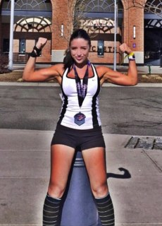 Photo of Katrina Vetrano wearing a medal from participating in the Spartan Race